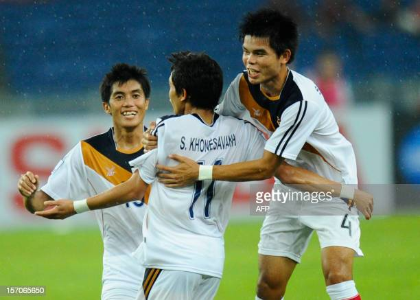 Laos's player Khonesavanh Sihavong celebrates a goal with teammates against Malaysia during their AFF Suzuki Cup group B football match in Bukit...