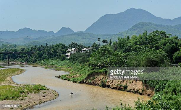 A Laotian fisherman casts his net in the Mekong river in Luang Prabang on May 4 2012 The Lao government had targeted a GDP value of 70200 billion kip...