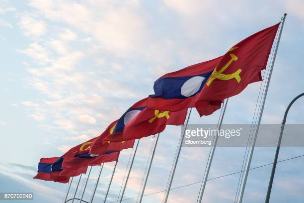 Laotian flags fly on a promenade along the Mekong river in Vientiane Laos on Thursday Nov 2 2017 Located in the Mekong region Southeast Asia's...