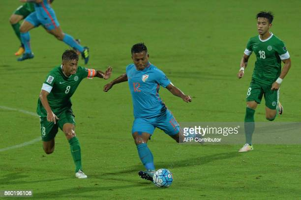 Lapekhlua of India and Cheang Cheng chase the ball during the 2019 AFCAsian Cup qualifying match between India and Macau held at the Kanteerava...