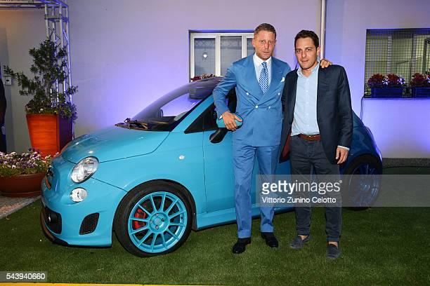 Lapo Elkann and Italia Independent Ideas CEO Alberto Fusignani attend the Learjet 31 'Nel Blu Dipinto Di Blu' Unveling At Linate SEA Prime on June 27...