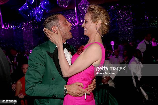 Lapo Elkann and Uma Thurman attend the amfAR's 23rd Cinema Against AIDS Gala at Hotel du CapEdenRoc on May 19 2016 in Cap d'Antibes France