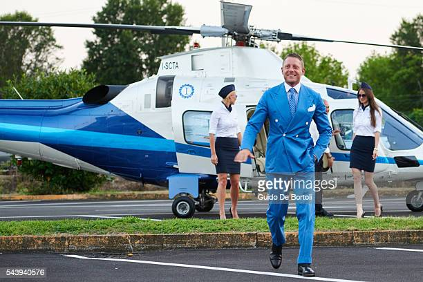 Lapo Elkann arrives in helicopter at the Learjet 31 'Nel Blu Dipinto Di Blu' Unveling At Linate SEA Prime on June 27 2016 in Milan Italy