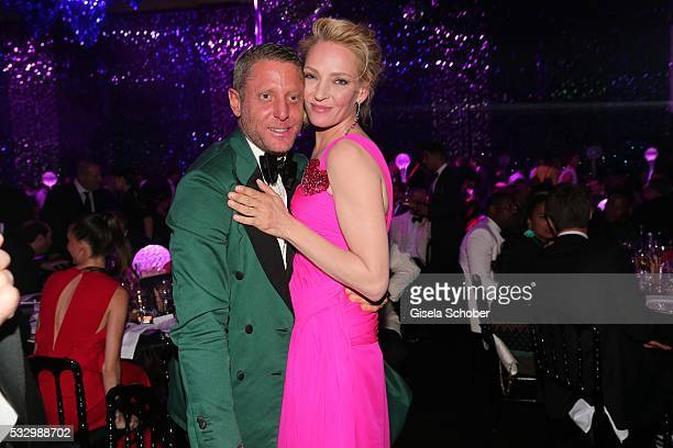 Lapo Elkann kisses Uma Thurman during the amfAR's 23rd Cinema Against AIDS Gala at Hotel du CapEdenRoc on May 19 2016 in Cap d'Antibes France