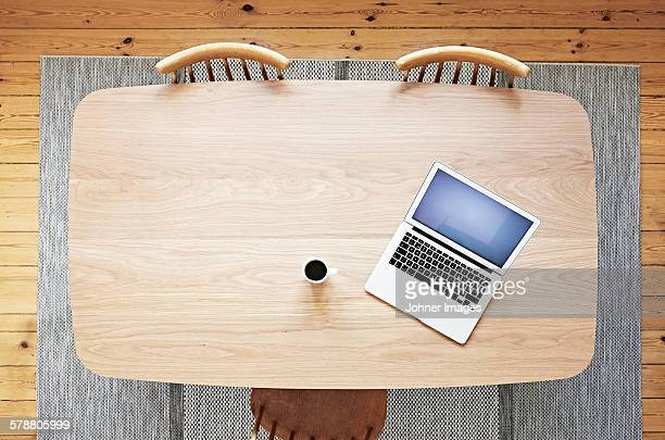 Laptop and coffee on wooden desk