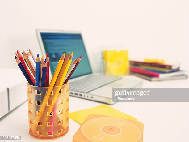 Laptop and colorful stationeries on desk