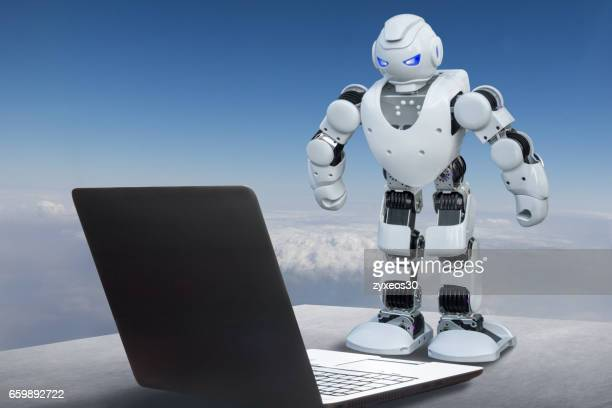 laptop and robot,Computer generated post-production.Robot in the operation computer,Futuristic concept.