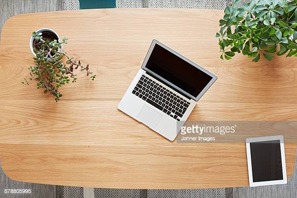 Laptop and tablet on wooden desk