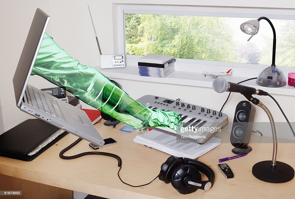Laptop arm playing music : Stock Photo