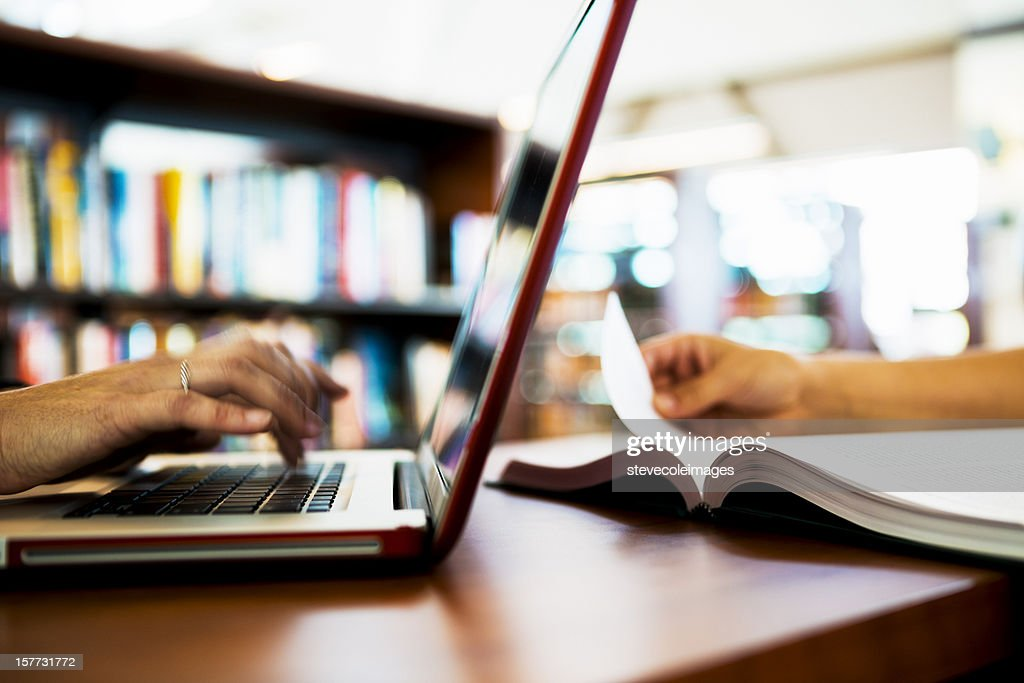Laptop Computer and Book on Table : Stock Photo
