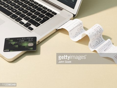 Laptop computer and reciept roll : Stock-Foto