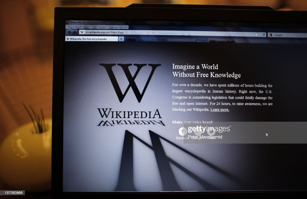 A laptop computer displays Wikipedia's front page showing a darkened logo on January 18, 2012 in London, England. The Wikipedia website has shut down it's English language service for 24 hours in protest over the US anti-piracy laws.
