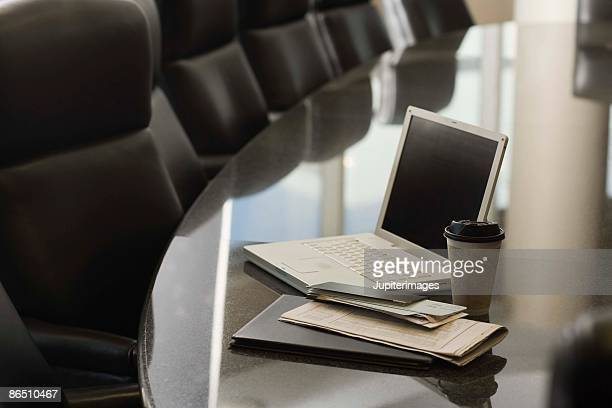 Laptop computer on table in conference room