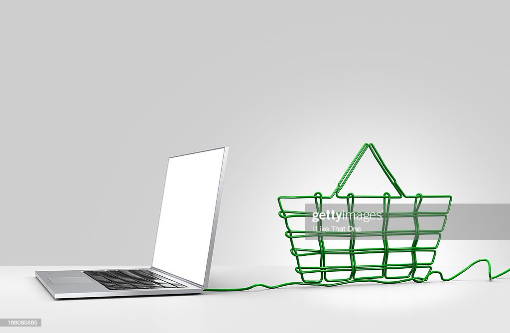 Laptop computer with cable forming a basket : Stock Photo