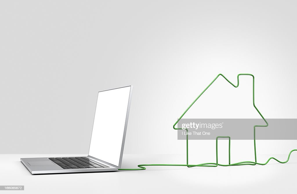 Laptop computer with cable forming a house