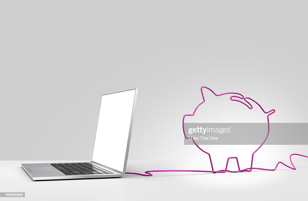 Laptop computer with cable forming a piggy bank : Stock Photo