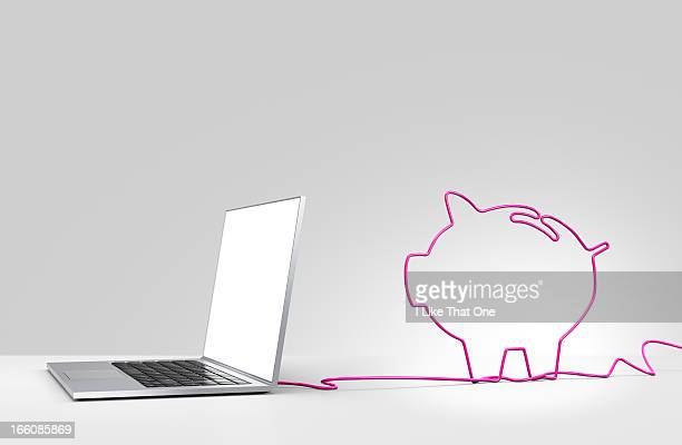 Laptop computer with cable forming a piggy bank