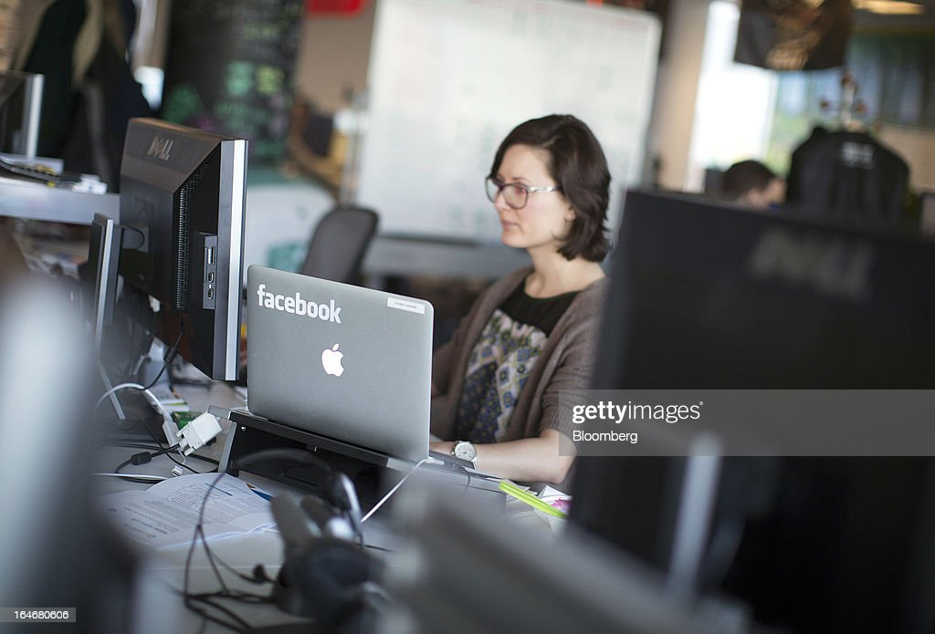 A laptop computer with the Facebook logo is seen on display in the offices of Facebook Inc.'s European headquarters at Hanover Quay in Dublin, Ireland, on Thursday, March 14, 2013. Ireland's renewed competiveness makes it a beacon for the U.S. companies such as EBay, Google Inc. and Facebook Inc., which have expanded their operations in the country over the past two years. Photographer: Simon Dawson/Bloomberg via Getty Images