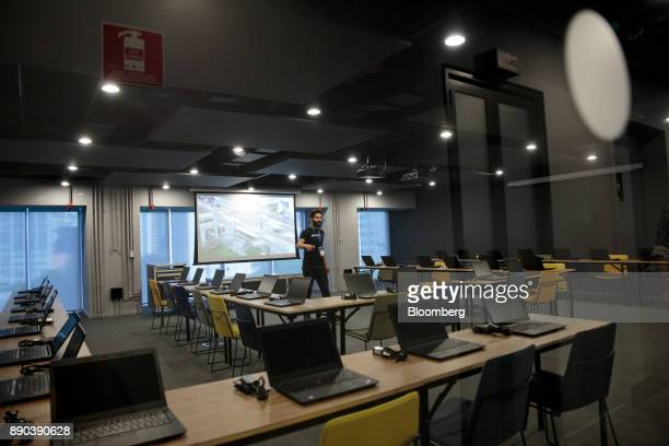 Laptop computers sit on communal workstations in a classroom at the Facebook Inc Hack Station in Sao Paulo Brazil on Monday Dec 11 2017 The Facebook...