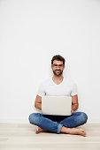 Laptop guy sitting on floor, portrait