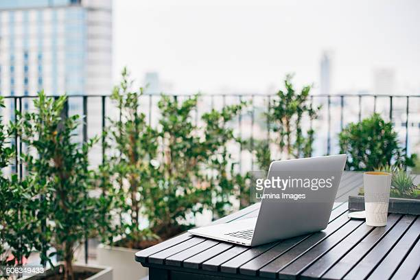 Laptop on balcony table