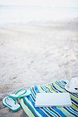 Laptop on beach towel