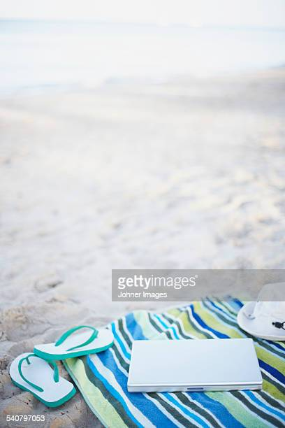 Laptop on beach towel