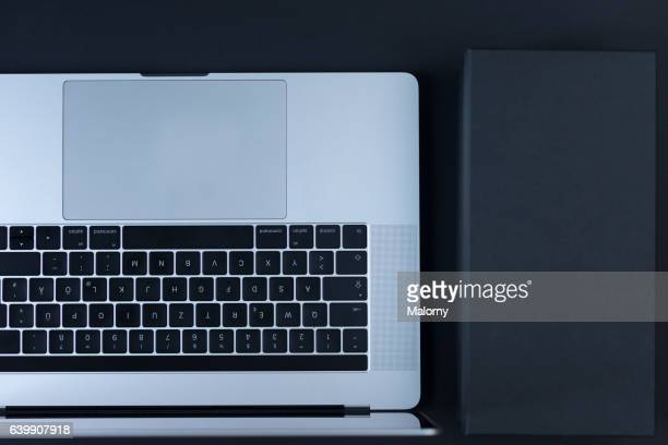 Laptop on black background, high angle view, flat lay, knolling, overhead, top view