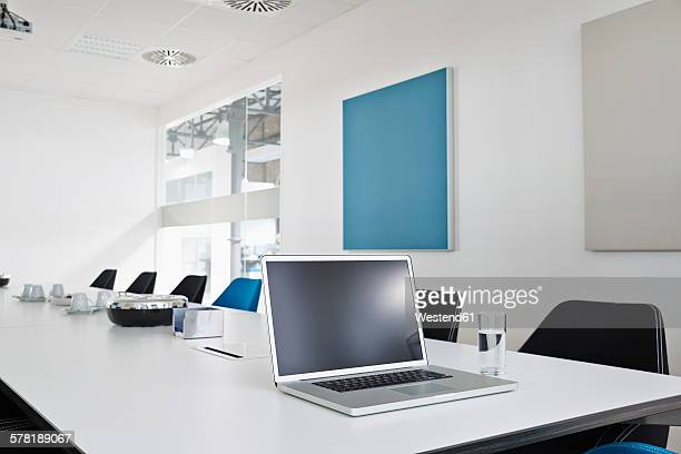 Laptop on conference table