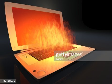 laptop on fire with computer virus : Stock Photo