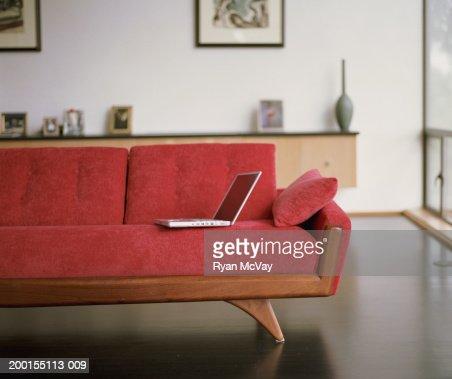 Laptop on sofa : Stock Photo