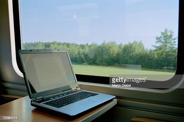 Laptop on table in passenger train