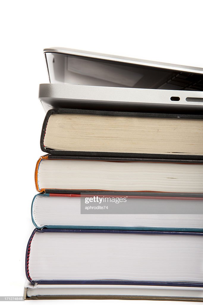 laptop opened on books