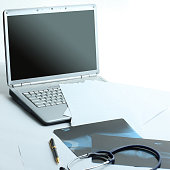laptop ,stethoscope and x-ray on the table .photo with copy space