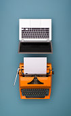 Top view banner of laptop and retro typewriter comparison