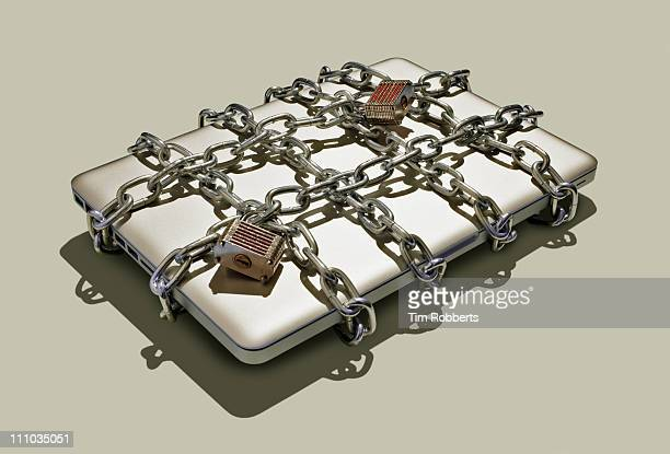 Laptop with chains and padlocks.
