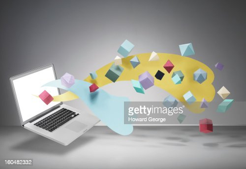Laptop with geometric shapes floating from screen : Stock Photo