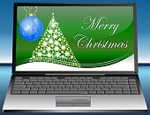 laptop with merry christmas greetings on green desktop - 3D illustration