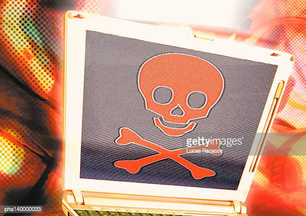 Laptop with skull and crossbones, digital composite.