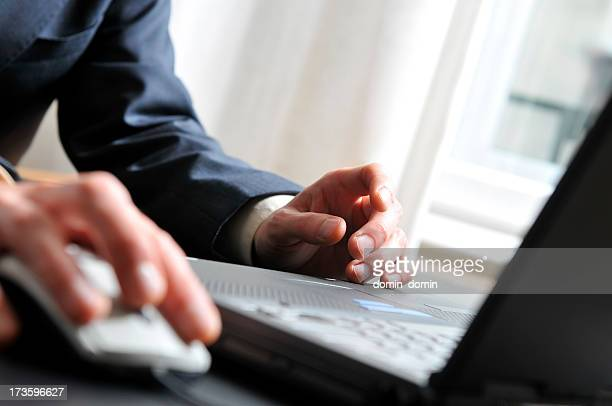 Laptop work, close-up on hands and computer
