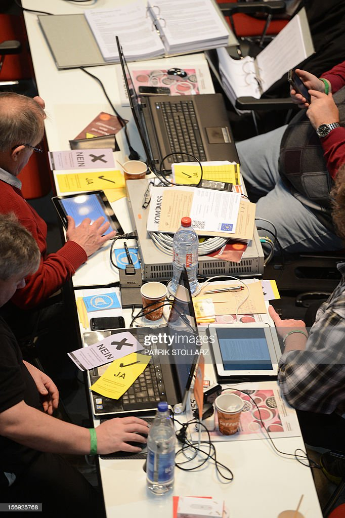 Laptops are placed on a table at a party congress of the Pirates Party in Bochum, western Germany, on November 25, 2012. The Pirate Party is meeting for two days to prepare a party platform for the 2013 general elections. AFP PHOTO / PATRIK STOLLARZ