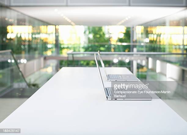 Laptops on desk in modern office