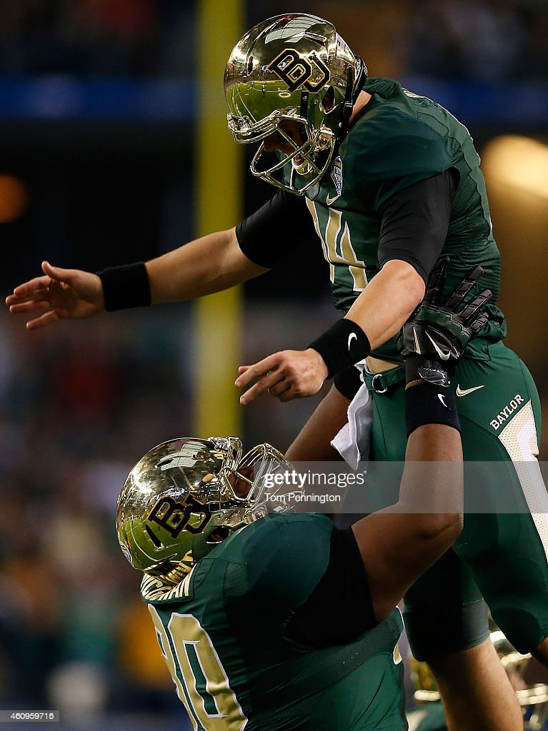LaQuan McGowan of the Baylor Bears and Bryce Petty of the Baylor Bears celebrate McGowan's touchdown against the Michigan State Spartans during the...