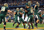 LaQuan McGowan of the Baylor Bears celebrates his touchdown against the Michigan State Spartans with Shock Linwood of the Baylor Bears and Bryce...