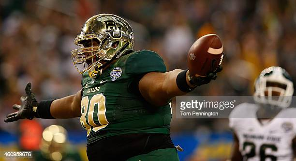 LaQuan McGowan of the Baylor Bears runs for a touchdown after the catch against the Michigan State Spartans during the second half of the Goodyear...