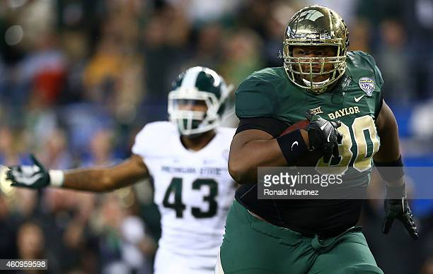 LaQuan McGowan of the Baylor Bears runs for a touchdown against the Michigan State Spartans during the second half of the Goodyear Cotton Bowl...