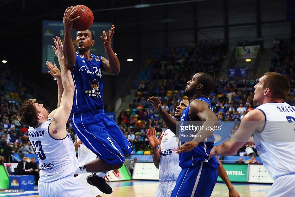 LaQuan Prowell of Skyliners is challenged by Scott Morrison of Eisbaeren during the Beko BBL match between Fraport Skyliners and Eisbaeren...