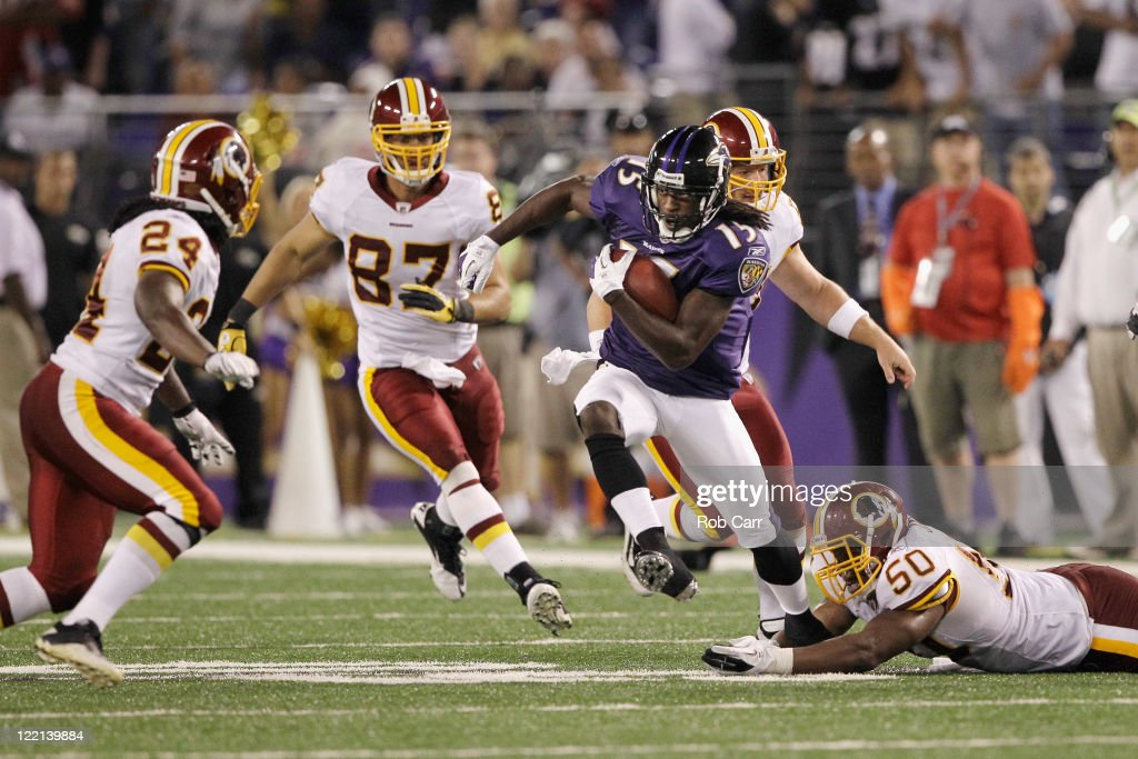 LaQuan Williams #15 of the Baltimore Ravens returns a punt against the Washington Redskins during the second half of a preseason game at M&T Bank Stadium on August 25, 2011 in Baltimore, Maryland. The Ravens defeated the Redskins 34-31.