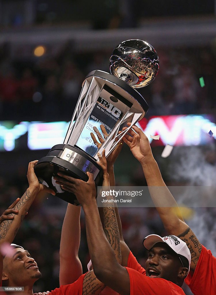 LaQuinton Ross #10 (L) and Evan Ravenel #30 of the Ohio State Buckeyes holds the trophy after the Buckeyes defeated the Wisconsin Badgers during the Big Ten Basketball Tournament Championship game at United Center on March 17, 2013 in Chicago, Illinois. Ohio State defeats Wisconsin 50-43.