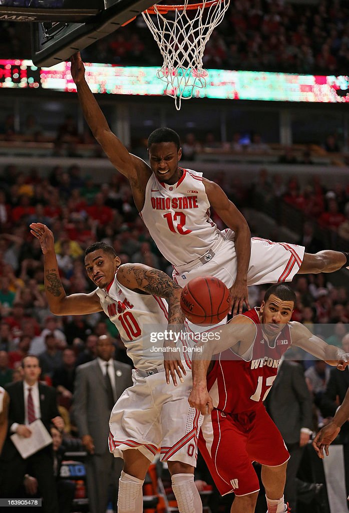 LaQuinton Ross #10 and Sam Thompson #12 of the Ohio State Buckeyes and Traevon Jackson #12 of the Wisconsin Badgers collide while going after a rebound during the Big Ten Basketball Tournament Championship game at United Center on March 17, 2013 in Chicago, Illinois. Ohio State defeated Wisconsin 50-43.